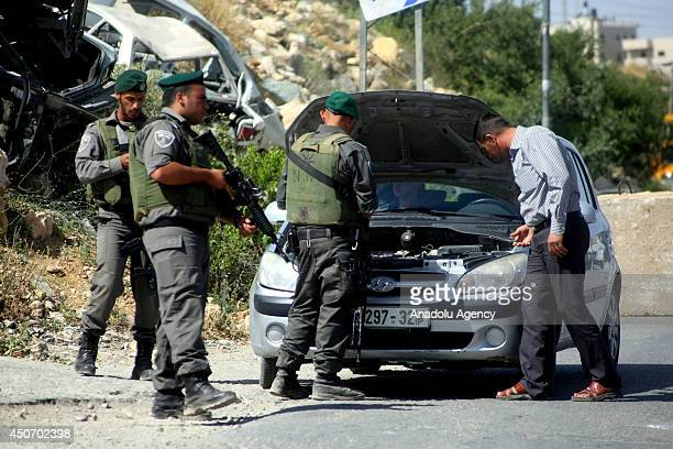Israeli soldiers patrol to search three young Jewish settlers in Hebron West Bank on June 16 2014 The threeday closure had come as part of a series...