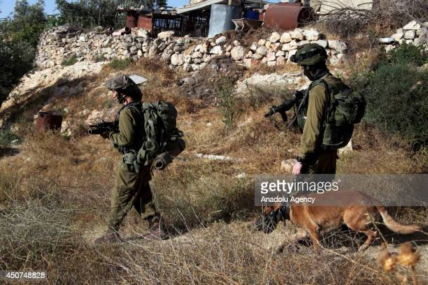 Israeli soldiers patrol to search three young Jewish settlers in Hebron West Bank on June 17 2014 The fourday closure had come as part of a series of...