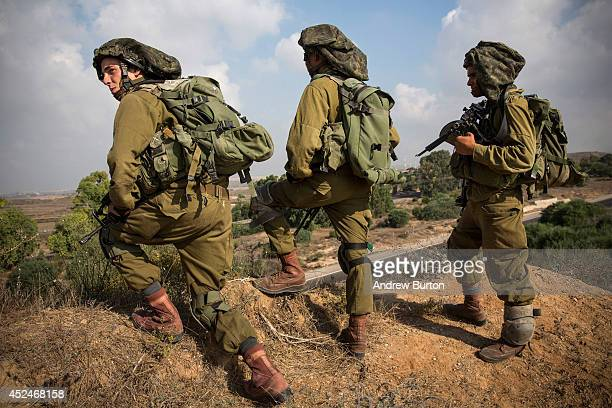 Israeli soldiers position themselves on a hill overlooking the IsraeliGaza border during operation 'Protective Edge' on July 21 2014 near Sderot...