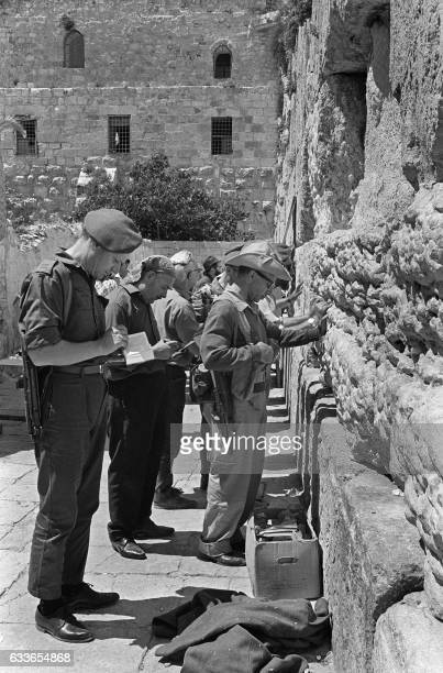 Israeli soldiers pray 09 June 1967 at the Wailing Wall in Jerusalem after the conquest by Tsahal over Jordan of the eastern part of the Holy City...