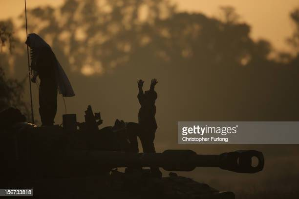 Israeli soldiers pray at dawn as the conflict between Palestine and Gaza enters its seventh day on November 20 2012 on Israel's border with the Gaza...