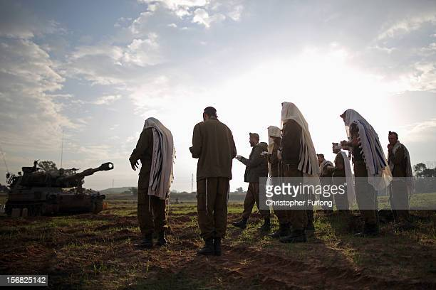 Israeli soldiers pray at dawn at an artillery emplacement on November 22 2012 close to the northern Gaza Strip border with Israel The ceasefire...