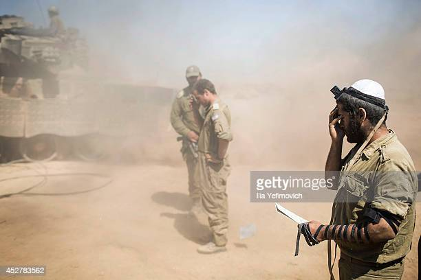 Israeli soldiers pray near the Israeli Gaza border as the 24 hour ceasefire begins on July 27 2014 on the Israeli/Gaza border Israel Fortytwo Israeli...