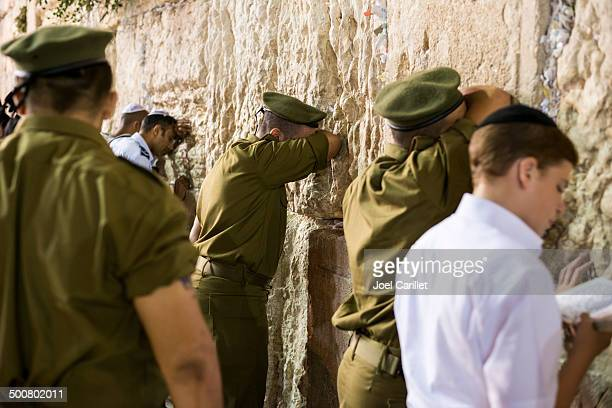 praying at the western wall - soldier praying stock photos and pictures