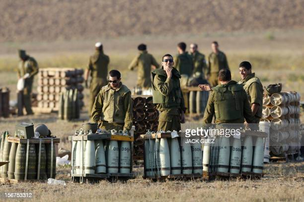 Israeli soldiers prepare artillery shells on November 20 2012 on the IsraelGaza border A ceasefire to end almost a week of violence in and around the...