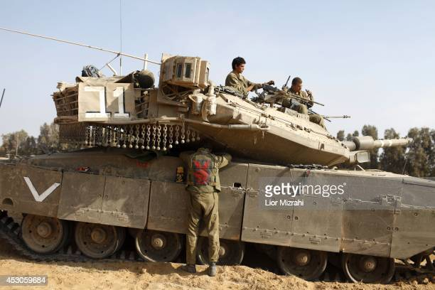 Israeli soldiers prepare their tanks in a deployment area on August 02 2014 on Israel's border with the Gaza Strip The Israeli military on Friday...