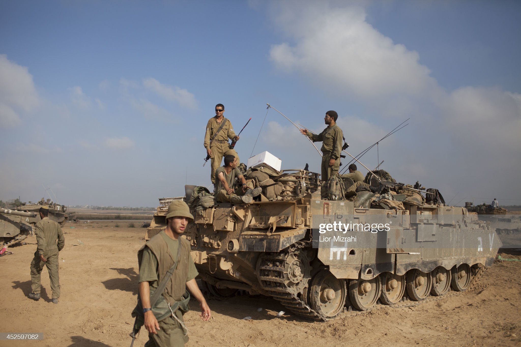 https://media.gettyimages.com/photos/israeli-soldiers-prepare-their-tanks-in-a-deployment-area-on-july-24-picture-id452597082?s=2048x2048