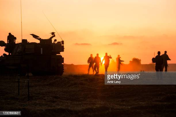 Israeli soldiers prepare thier artillery unit near the border with Gaza Strip on May 14, 2021 in Sderot, Israel. This follows days of violence and...
