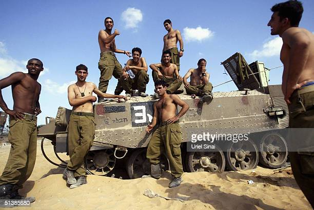 Israeli soldiers prepare to enter Beit Hanun at the border between Nisanit and the Gaza Strip town of Beit Hanun October 3 2004 in Gaza Strip Israeli...