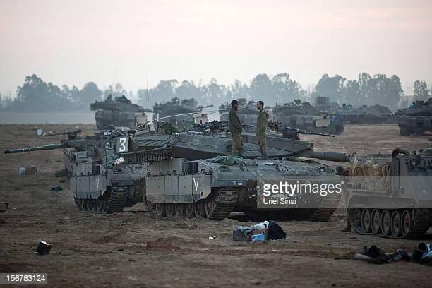 Israeli soldiers prepare weapons and vehicles in a deployment area on November 21 2012 on Israel's border with the Gaza Strip Despite widespread...