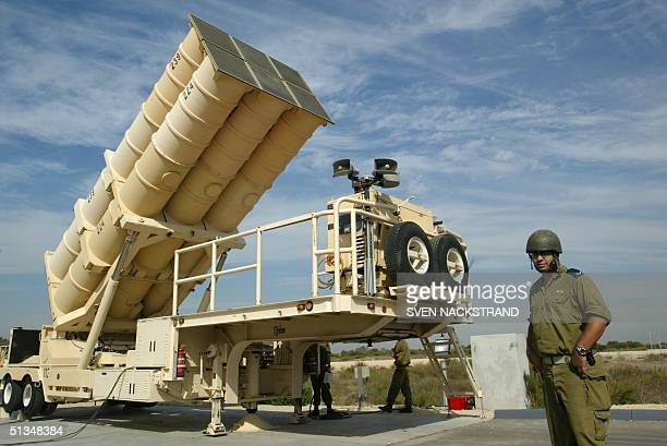 Israeli soldiers raise to it's upright position an Arrow missile launcher with it's six missiles during a tour for foreign correspondents at the...