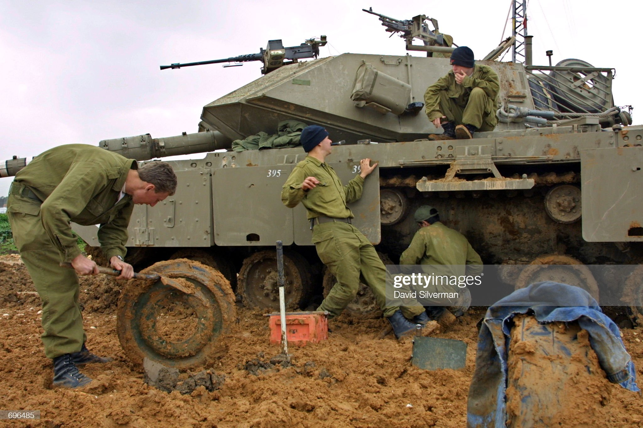 https://media.gettyimages.com/photos/israeli-soldiers-repair-their-tanks-tracks-february-12-2002-where-picture-id696485?s=2048x2048