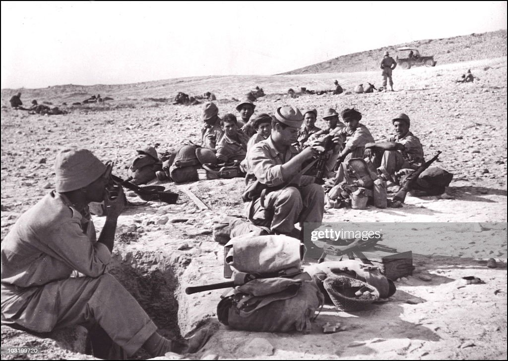 Israeli soldiers rest at the Sinai peninsula desert during the
