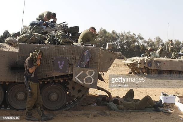 Israeli soldiers rest in a deployment area on August 02 2014 on Israel's border with the Gaza Strip The Israeli military on Friday cited indications...