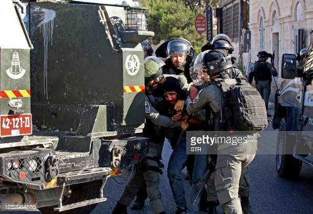 Israeli soldiers restrain a Palestinian protester amid confrontations that took place during a demonstration against Israeli occupation in the West...