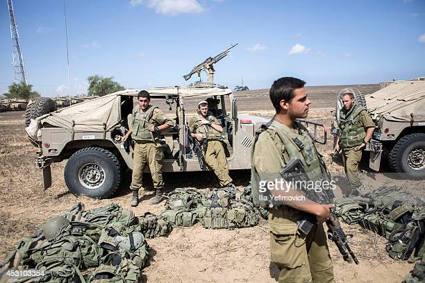 Israeli soldiers return from Gaza on August 3 2014 near the border with Gaza Israel As Operation Protective Edge enters its 27th day a large amount...