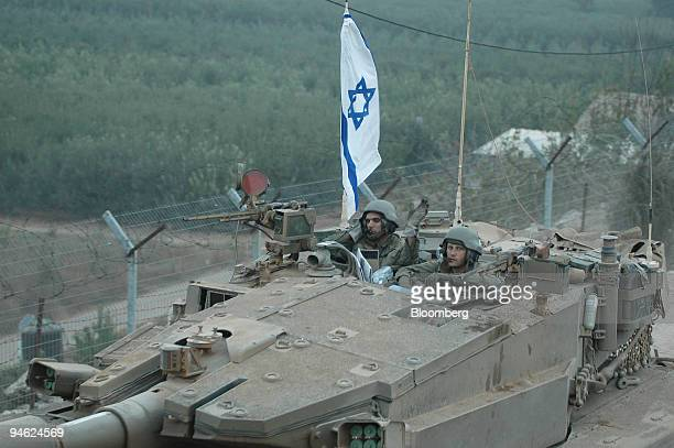 Israeli soldiers return from Southern Lebanon to the northern Israeli town of Metula on Tuesday August 15 2006 Israel and Hezbollah observed a...