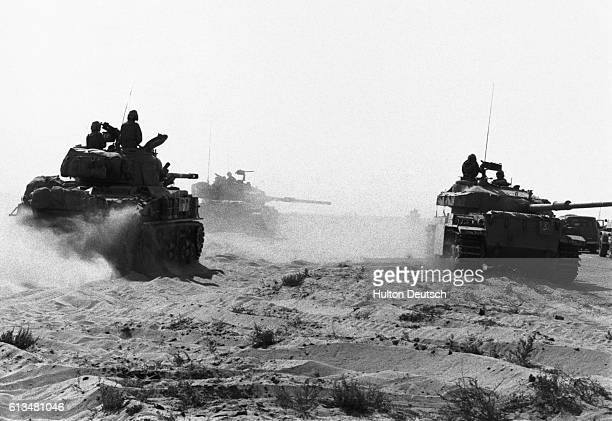 Israeli soldiers ride through the Egyptian desert in tanks during the Yom Kippur War