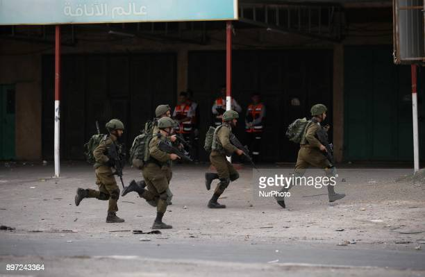 Israeli soldiers run during clashes with Palestinian demonstrators at a protest as Palestinians call for a quotDay of Ragequot in response to US...