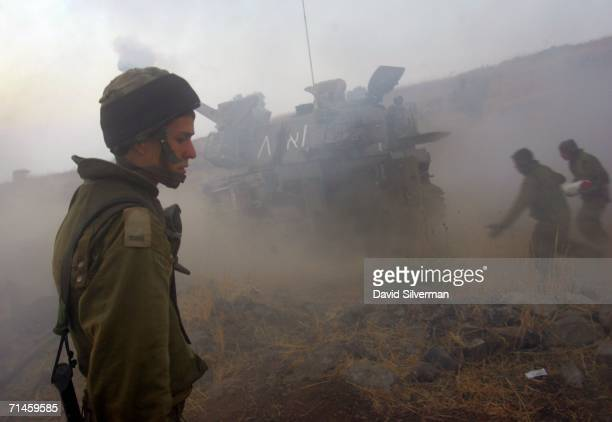 Israeli soldiers run to reload a 155mm artillery cannon during a barrage against Hezbollah targets in South Lebanon July 16 2006 from a forward base...