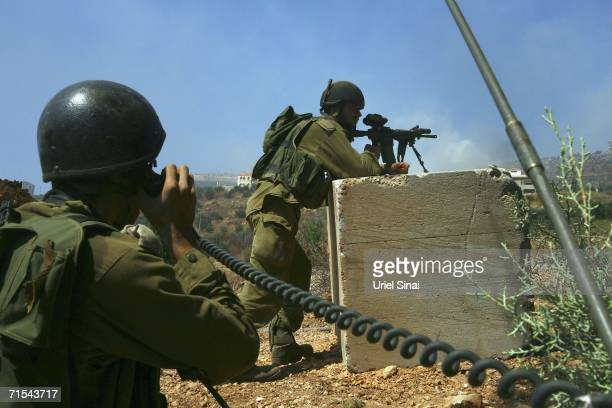 Israeli soldiers secure the area as they try to recover a disabled Israeli tank after it was hit by a Hezbollah rocket in Kafar Kila on July 31 2006...