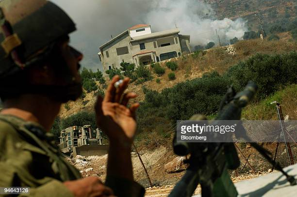 Israeli soldiers shell a Lebanese town from the border near the town of Metulah Israel on Monday July 31 2006 US Secretary of State Condoleezza Rice...
