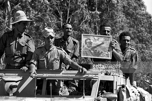 Israeli soldiers showing a portrait of the Egyptian President Gamal Abdel Nasser who was defeated in the Six Day War June 1967
