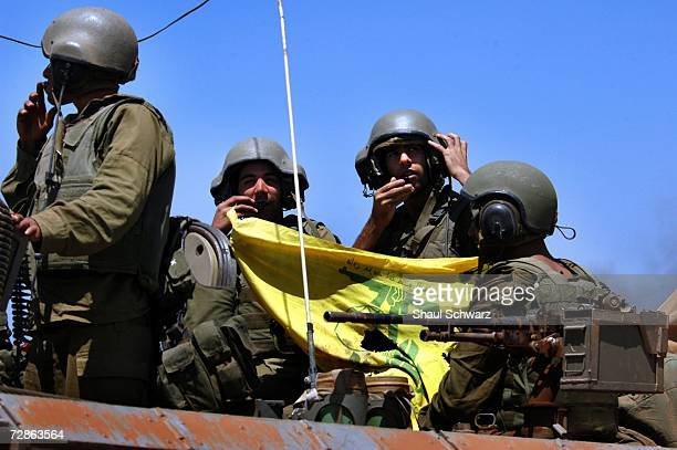 Israeli soldiers shows a Hezbollah flag as they come back from action against Hezbollah guerillas in south Lebanon July 25 2006 on the...