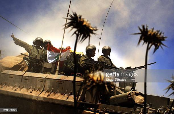 Israeli soldiers shows a Lebanon and Hezbollah flags as they come back from action against Hezbollah guerillas in south Lebanon July 25 2006 on the...