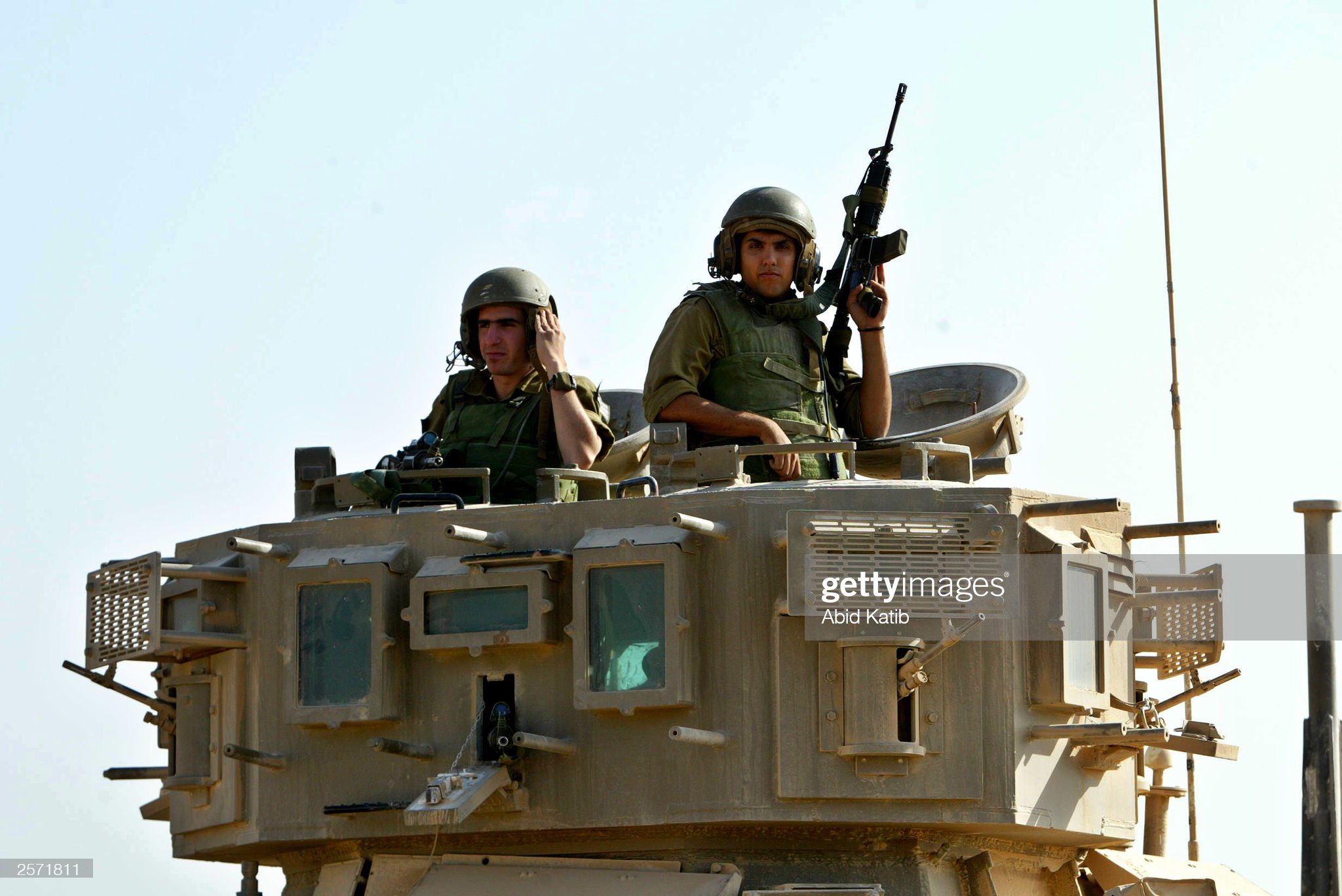 https://media.gettyimages.com/photos/israeli-soldiers-sit-in-their-tank-as-they-reblock-the-junction-on-picture-id2571811?s=2048x2048