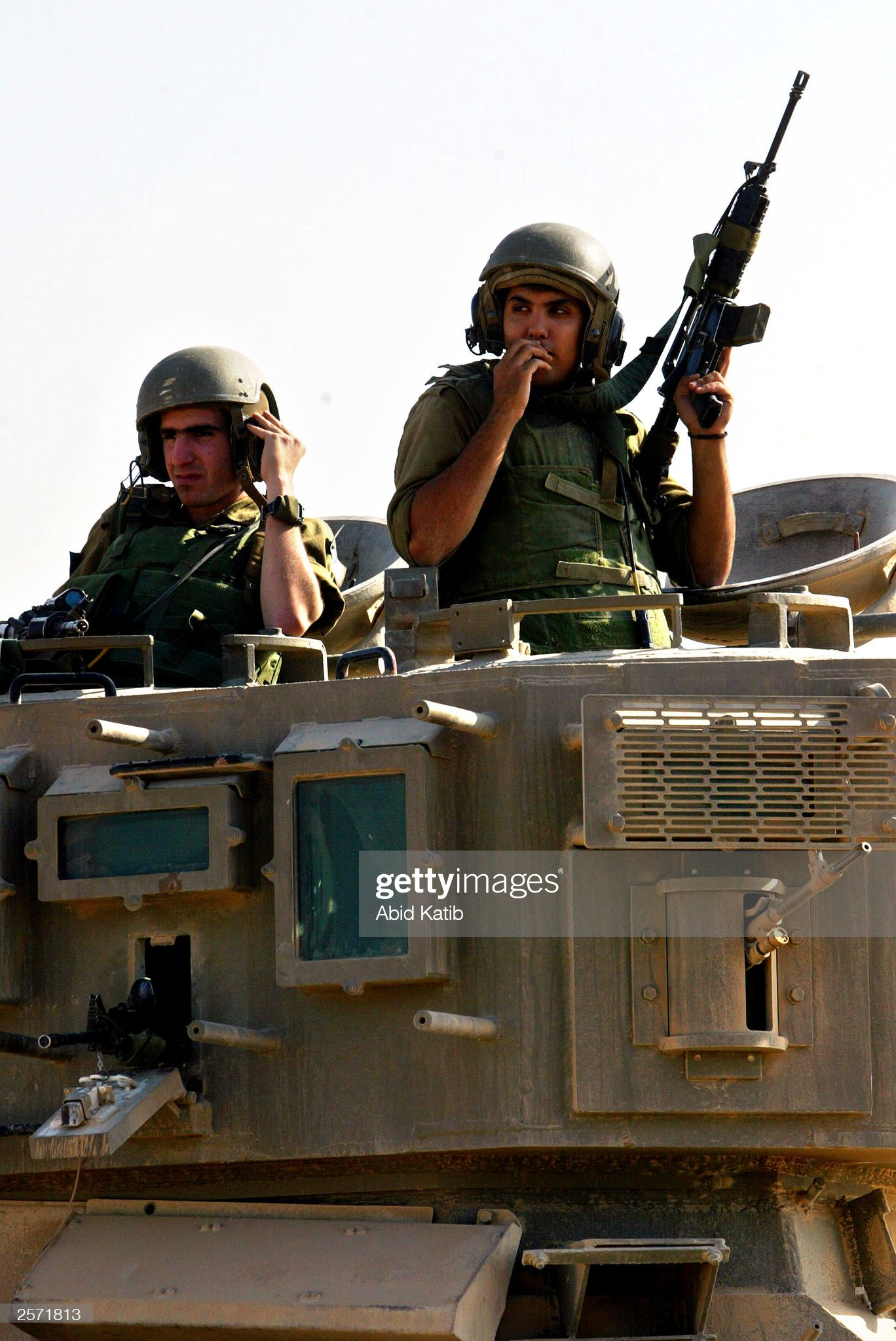https://media.gettyimages.com/photos/israeli-soldiers-sit-in-their-tank-as-they-reblock-the-junction-on-picture-id2571813?s=2048x2048