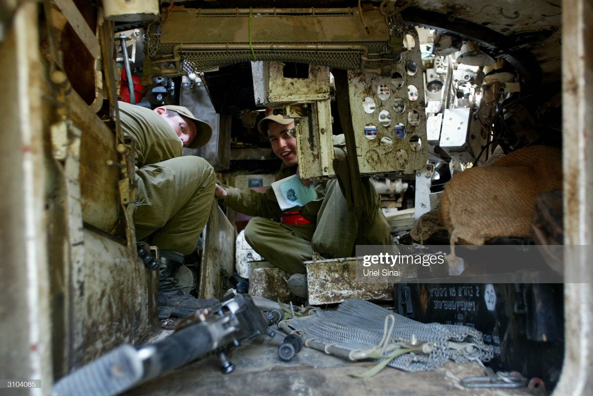 https://media.gettyimages.com/photos/israeli-soldiers-sit-inside-a-merkeva-mark-ii-tank-as-their-unit-17-picture-id3104085?s=2048x2048