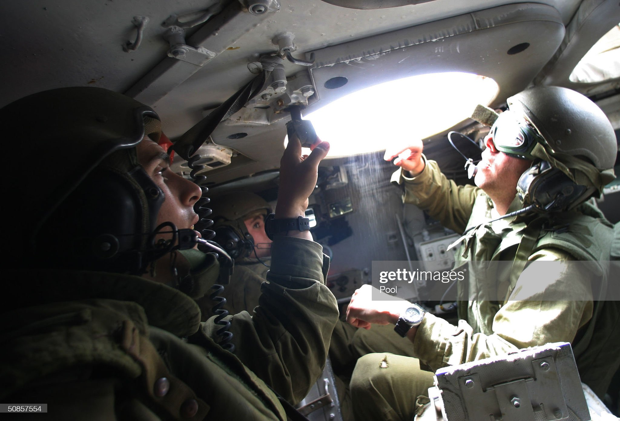 https://media.gettyimages.com/photos/israeli-soldiers-sit-inside-the-armoured-personnel-carrier-during-the-picture-id50857554?s=2048x2048