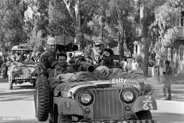 Israeli soldiers smile in their jeep on June 13 1967 on the road between Jerusalem and Bethlehem in the occupied West bank On 05 June 1967 Israel...