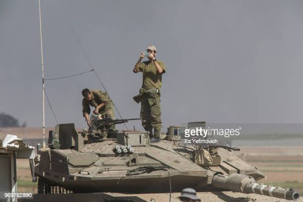Israeli soldiers stand along the border during a Palestinian protest on the IsraelGaza border on June 8 2018 in Nahal Oz area Israel Naksa is Arabic...
