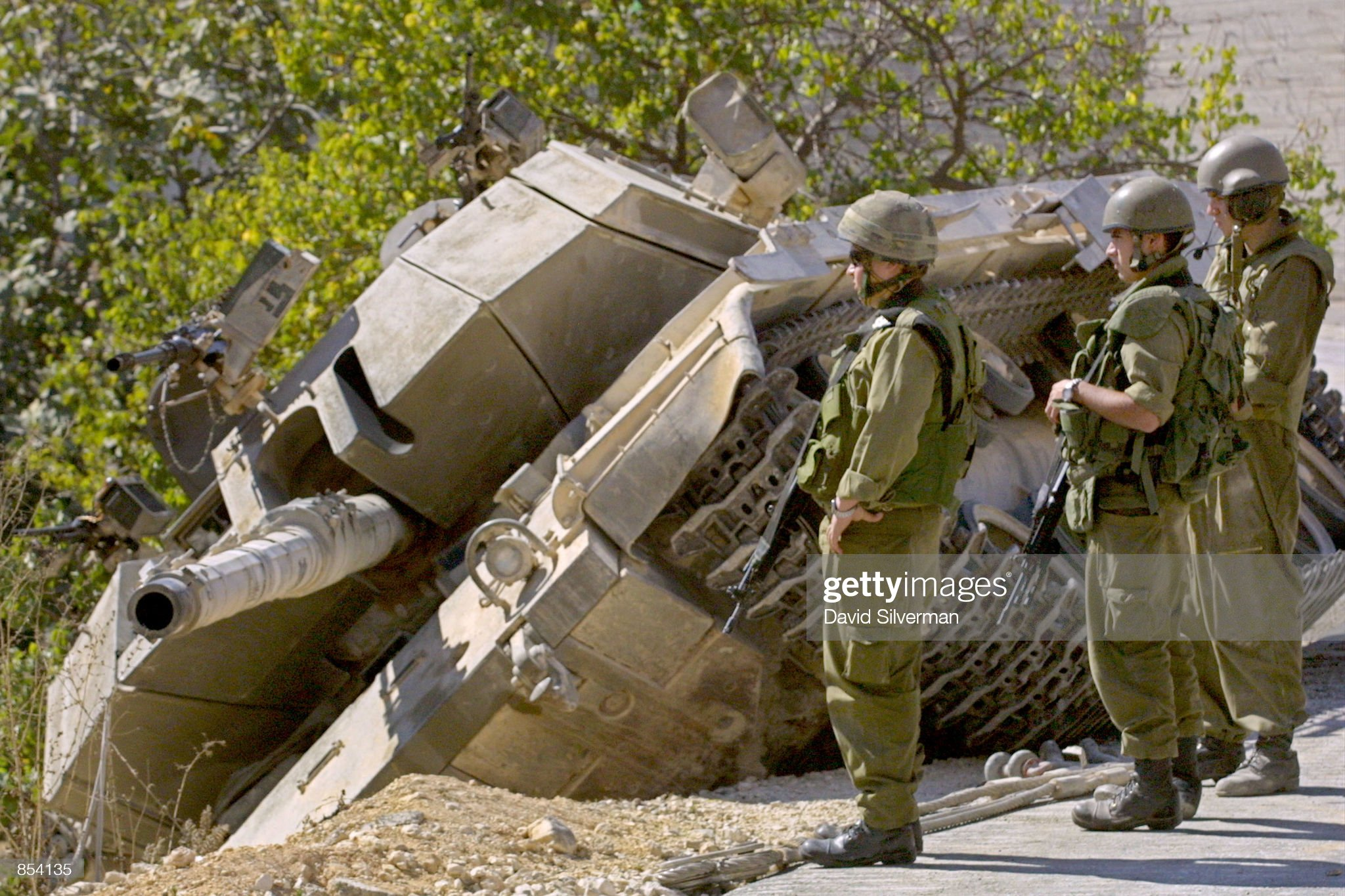 https://media.gettyimages.com/photos/israeli-soldiers-stand-by-their-tank-october-26-2001-after-they-drove-picture-id854135?s=2048x2048