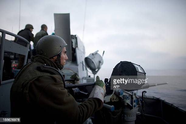 Israeli soldiers stand guard aboard a missile ship as the Israeli navy intercepts a Gazabound aid flotilla in the Mediterranean Sea on May 31 2010 in...