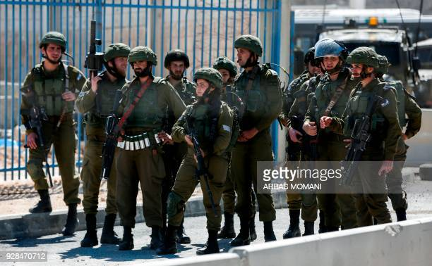 TOPSHOT Israeli soldiers stand guard at Qalandiya checkpoint in the occupied West Bank between Jerusalem and Ramallah on March 7 2018 during a...