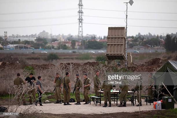 Israeli soldiers stand guard by the Iron Dome defense system launch site on November 17, 2012 in Tel Aviv, Israel. At least 39 Palestinians and three...