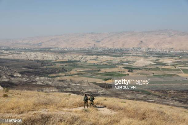 TOPSHOT Israeli soldiers stand guard in an old army outpost overlooking the Jordan Valley between the Israeli city of Beit Shean and the West Bank...