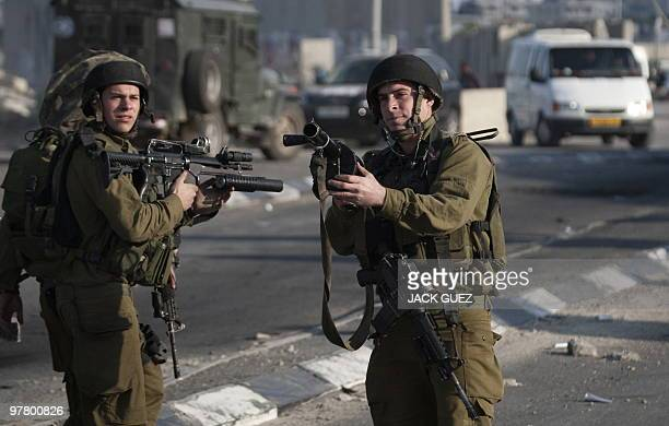 Israeli soldiers stand guard near the Qalandia crossing between the West Bank and Jerusalem during clashes on March 17 2010 with Palestinian...