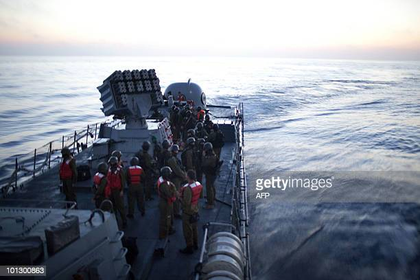 Israeli soldiers stand guard on a missile ship as the Israeli navy intercepts a Gazabound aid flotilla in the Mediterranean Sea on May 31 killing...