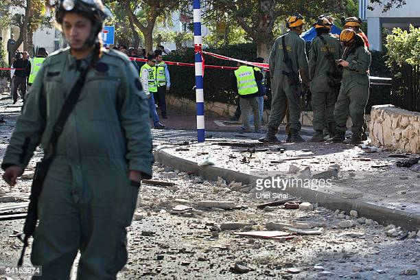 Israeli soldiers stand in debris after a Palestinian rocket hit an 8 story building on January 01 2009in Ashdod Israel Israel and its Islamist Hamas...