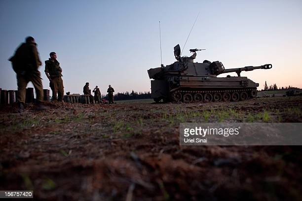 Israeli soldiers stand next to artillery guns as the conflict between Palestine and Gaza enters its seventh day on November 20 2012 on Israel's...