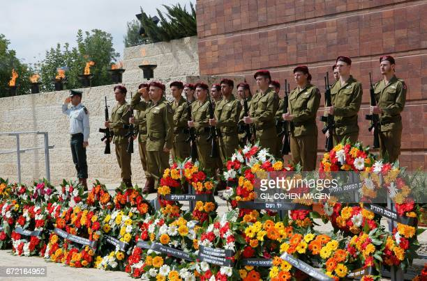 Israeli soldiers stand to attention during a ceremony marking the annual Holocaust Remembrance Day at the Yad Vashem Holocaust Memorial in Jerusalem...
