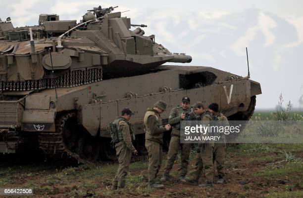 Israeli soldiers take part in a military training in the Israeliannexed Golan Heights near the IsraelSyria border on March 22 2017 Israel seized most...