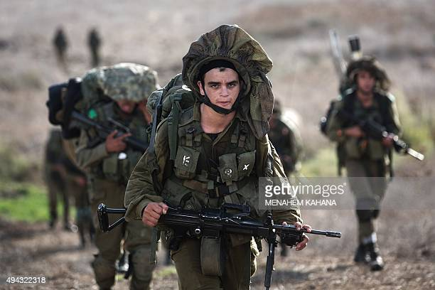 Israeli soldiers take part in an annual military exercise in the center of the Israeliannexed Golan Heights on October 26 2015 Since the Syrian...