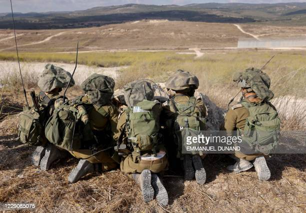 Israeli soldiers take part in military exercises near the northern Elyakim area on October 14 during a simulation to protect the country's northern...