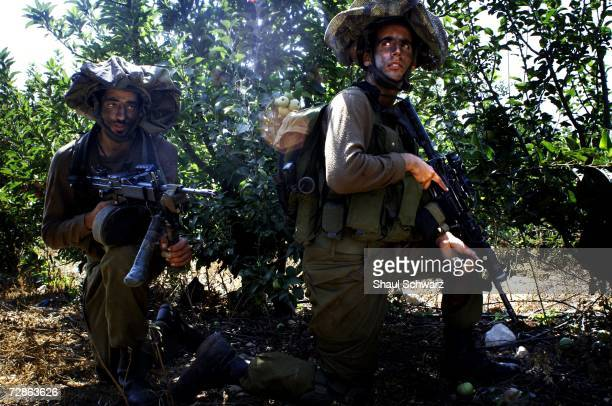 Israeli soldiers take positions along the Israeli Lebanese border prior to entering into Lebanon July 20 2006 in Israel Lebanese Prime Minister Fouad...