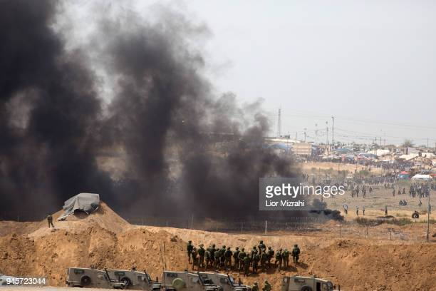 Israeli soldiers take positions as Palestinian gathered for a protest on the IsraelGaza border on April 13 2018 in Netivot Israel Thousands of Gaza...
